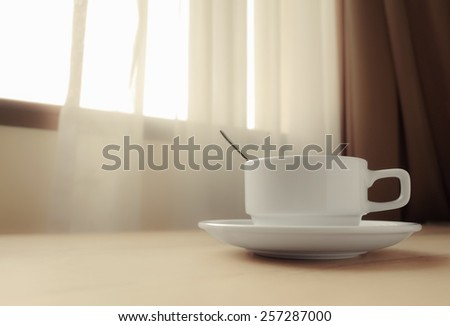 white coffee cup by the window - stock photo