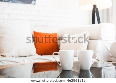 White coffee cup on table decoration in living room interior