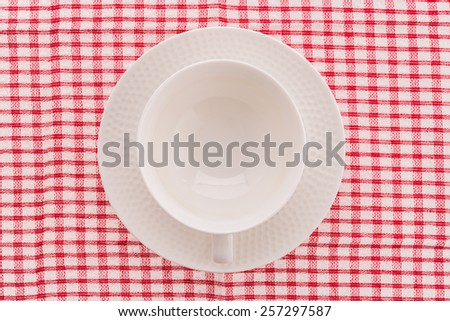 White coffee cup on tablecloth