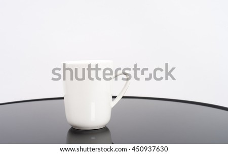 White coffee cup on the table reflect with white background