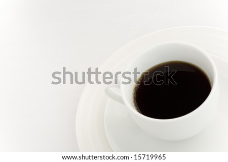 White coffee cup over a white background
