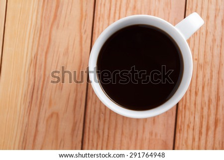 White coffee cup placed on a wooden brown. - stock photo