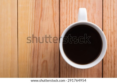 White coffee cup placed on a wooden brown.