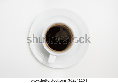 White coffee cup with coffee  on white background. View top. In studio