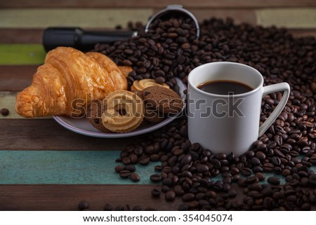 White coffee cup with cookies and beans - stock photo