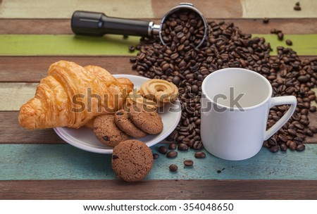 White coffee cup with cookies and beans background - stock photo