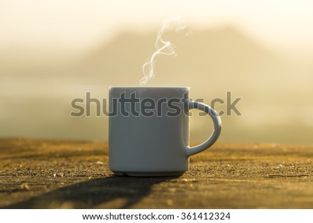 White Coffee cup with sunset time. - stock photo