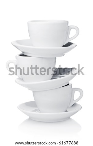 White coffee cups with saucers. Isolated on white - stock photo