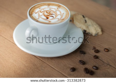 white coffee with cookie