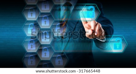 White collar criminal in blue suit is hacking holes into the security helix of a virtual firewall. His left hand is removing unlocked data packets with a swiping movement. Concept for cyber attack. - stock photo