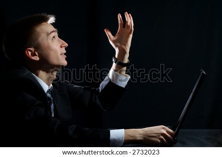 White collar worker raise hand over black background