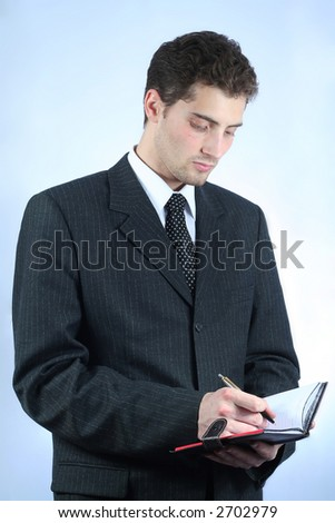 White-collar worker writing info over sky-blue background