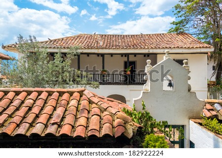 White colonial architecture and tiled roofing in the town of Villa de Leyva in Boyaca department in Colombia - stock photo