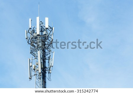 White color antenna repeater tower on blue sky, telecommunication concept - stock photo