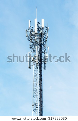 White color antenna repeater tower on blue sky, telecommunication concept