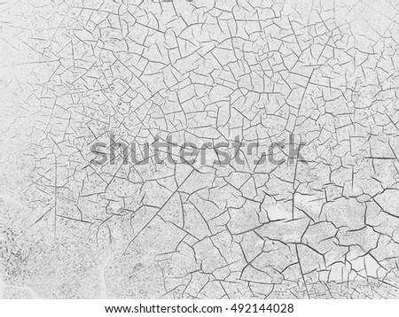 White color cracked on wall, abstract background.