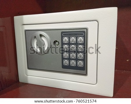 White color safe box on wood background