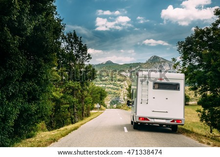 White Colour Motorhome Car Goes On Road On Background Of French Mountain Nature Landscape.