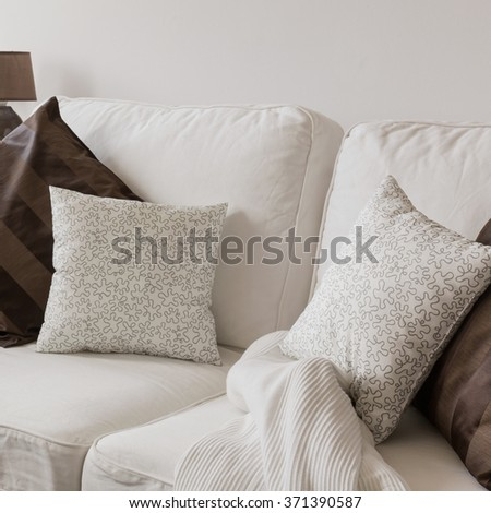 White comfortable cosy sofa with pillows