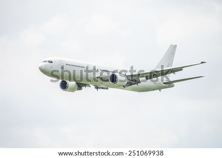 white commercial airplane on sky background  - stock photo