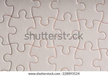 white complete jigsaw puzzle close up texture background concpet of success finished challenge task - stock photo