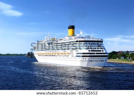 White Concordia-class cruise liner leaving port of Riga - stock photo
