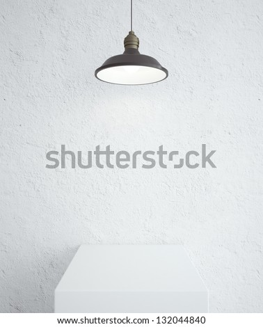 white concrete room with podium and lamp - stock photo