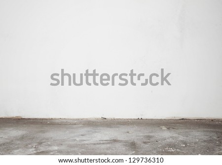 White construction stucco wall and cement floor - stock photo