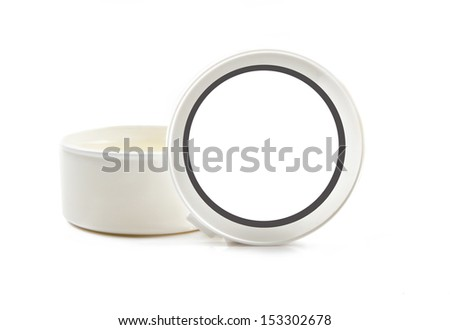 White container with salve or cream on white background - stock photo