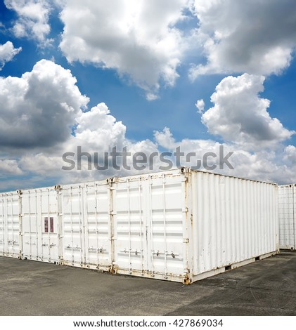 White containers on blue sky background - stock photo