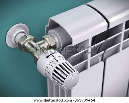 White contemporary heating radiator with thermostat isolated on white - stock photo