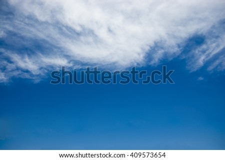 white continuous clouds against the blue sky - stock photo