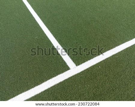 White corner marking on playing field - stock photo
