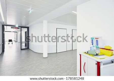 White corridor in hospital with trolley - stock photo