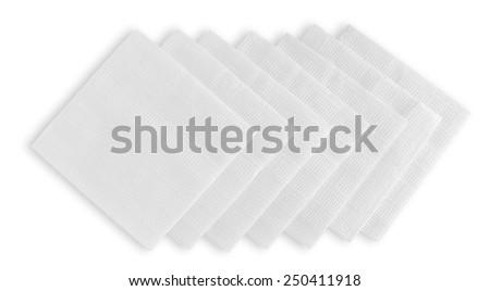 White corrugated paper napkins folded one on one isolated on white background. - stock photo