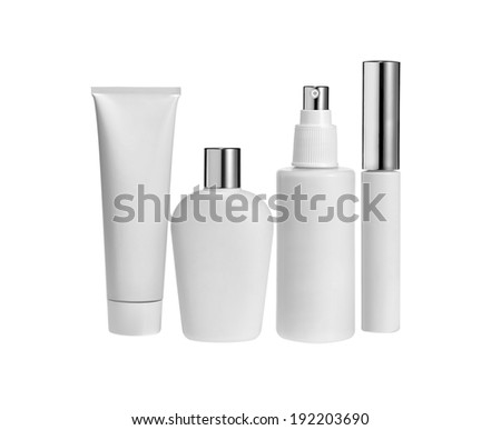 White Cosmetic containers isolated on white - stock photo