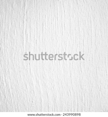 White cotton cloth used as a decorative piece of clothing.
