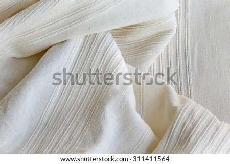 White cotton fabric as a background.