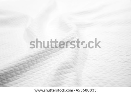 White cotton fabric texture, background photo of wavy blanket