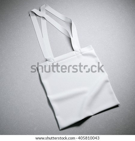 White cotton textile bag on a gray background. 3d rendering