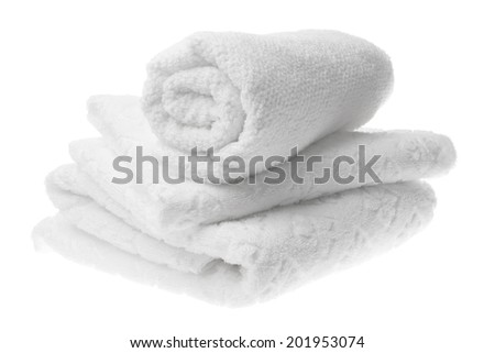 White cotton towels stack isolated - stock photo