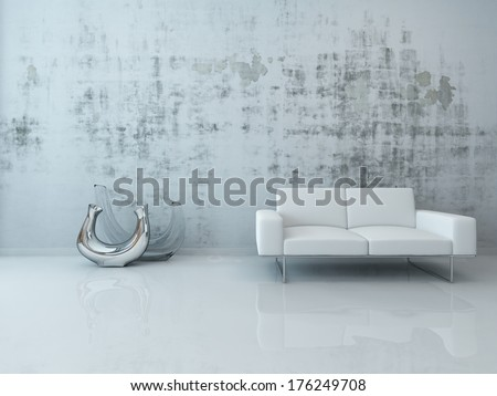 White couch against concrete wall - stock photo