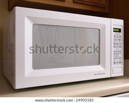 White counter top Microwave oven front view - stock photo