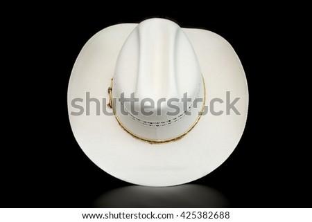 White Cowboy Hat on a Dark Background - stock photo