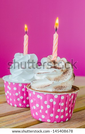White cream cupcake with candle - stock photo