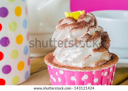 White cream cupcake with chocolate - stock photo