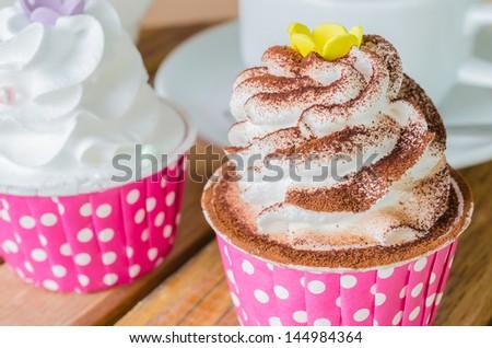 White cream cupcake with chocolate - stock photo
