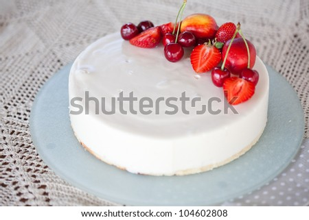 White Cream Icing Cake with Fruits - stock photo