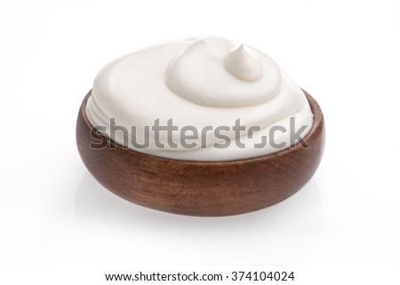 white cream or yogurt on white background  - stock photo