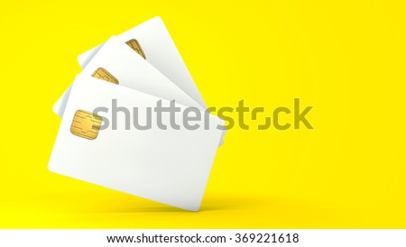 White credit card on yellow background - stock photo